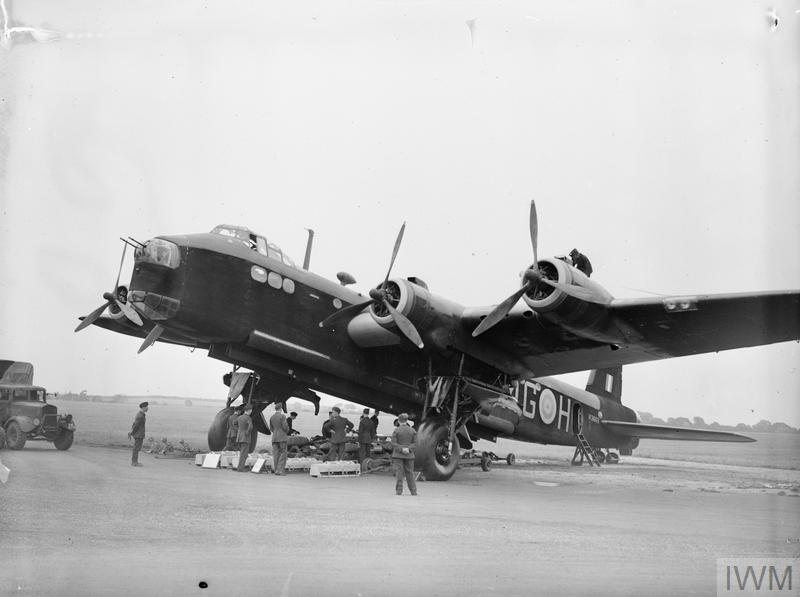 ROYAL AIR FORCE 1939-1945: BOMBER COMMAND (CH 3175) Stirling N3663/MG-H of No 7 Squadron, on display at Newmarket Heath, Suffolk, during a visit by King Peter of Yugoslavia, 29 July 1941. A typical bomb load is on view beneath the aircraft for the King's inspection. Copyright: © IWM. Original Source: http://www.iwm.org.uk/collections/item/object/205218641