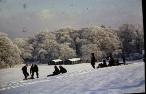 Tall Hill sledging with the golf club in the back ground