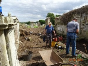 Gerald and John hard at it clearing rubble
