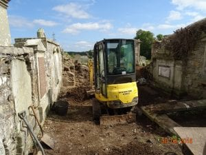 Mini digger to help with rubble removal