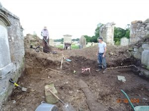 Starting to make our way to the back of the church. Note the stubs of railings to the side of Allan. Note the st