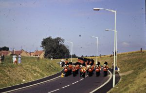 Coldstream Guards band marching down Guards Road 1968
