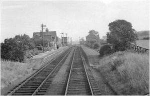 Served as the terminus of the line for 2 years until conection to Kelso (NBR) was completed in 1851. The end on junction with the NBR was 1 mile west of Sprouston, 1.75 miles east of Kelso. As the NER's last station on the line Sprouston had a single track engine shed from which the Kelso - Tweedmouth services operated. The shed was apparently rebuilt in 1882 after being damaged by a gale. Although, closed in 1916 the shed was used during World War II to house GWR City of Truro, evacuated from the York Railway Museum