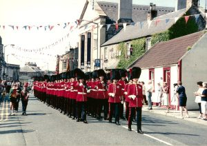 Guards march along High Street.  (Not sure what date)