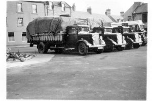 Bibby  trucks in the Market Square. Mr Benn who lived in Abbey House in the Market square was the agent for Bibby cattle feed  and was the owner of Hogg and Wood.