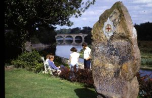 Guards stone in Henderson Park with the bridge in the back ground