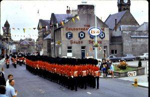 Coldstream Guards in town outside Coldstream Garage