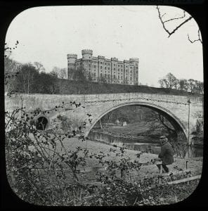 Twizell Castle, Bridge  with the fishing shiel just visible under the arch of the bridge. The fishery was called the weil