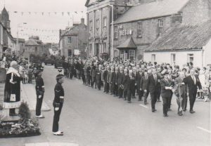 K O S B march through the town. With the old boys in front