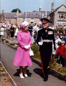 Queen Elizabeth II on her visit to Coldstream walking into Henderson Park With William Swan