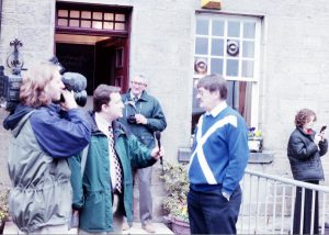 Outside the Besom Inn when the Stone of Destiny returned via Coldstream. The Land Lord Jim being interviewed by television.
