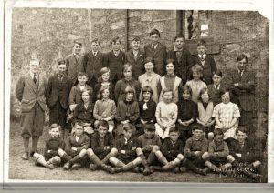 "Cornhill School From left to right top 1 Walter Baxter, 2 George Turnbull, 3 ? 4 Jim Tindle, 5 Willie Johnston, 6 Bob McGregor, 7 George Thomson, 8 Mr J D Cunningham ""School master"" 9 ?  10 Jack Tindle,11 Margaret Wilson, 12 ? 13 Ellan Wilson, 14  ? 15 Jean Embleton, 16 Adam Tait, 17 George William Baxter, 18 ? , 19 Freda Wilson 20 ?. 21 ?, 22 ?, 23 ?, 24 Molly Wilson, 25 Margaret Hume, 26 Douglas Cunningham, 27 Tom Turnbull, 28 Walter McGregor, 29 George Wilson, 30 ?. 31 Jimmy Smith, 32 ?, 33 ?, 34 ?"