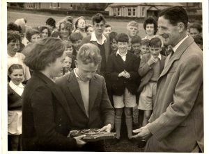 Jim Green and Eileen Jeffery at a sports day. We think its Wooler could be a rounders rally. about 1960.