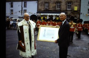 Sir Alex getting his Freedom of the burgh scroll from Provost Loyd