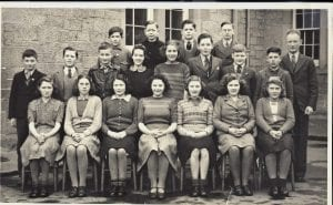 Head Master Jas. A. Jamison.  Back Row Left to Right  Walter Hope, Boyd Young, Fred Home, Ronnie Lambert.  Middle Row.\\r\\nGeorge Swan, Brian Turnbull, Frank Swan, Margi Campbell, Frances Wilson, Kay Wilson, Tom Raeburn, George Davidson.\\r\\nFront Row  Irene Wilson, Daphne Robson, Jean Clazie, Eileen Fleming, Ann Law, Margaret Younger, Nan Bain.