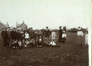 Children  in the Home Park. The School house in the back ground