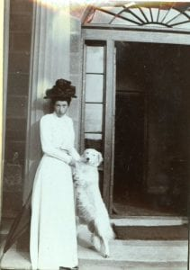 Lady with dog outside Lennel House