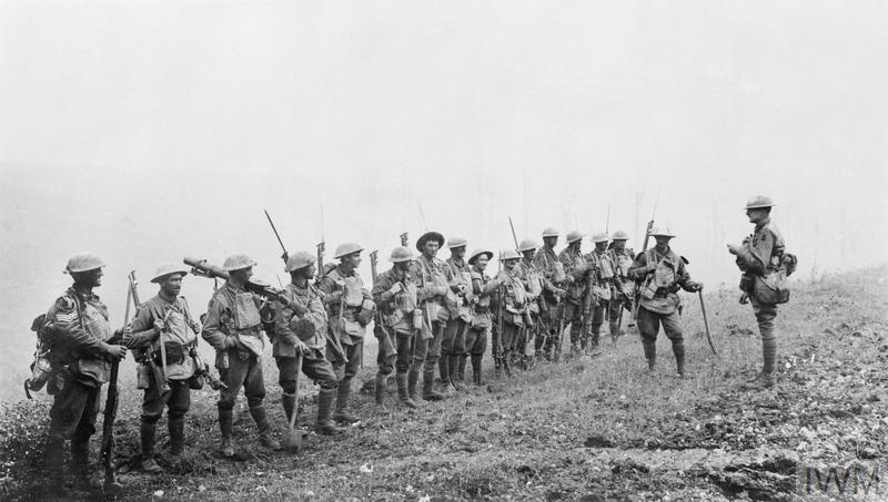 AUSTRALIAN FORCES ON THE WESTERN FRONT DURING THE FIRST WORLD WAR (E (AUS) 2790) An under-strength platoon of the 5th Australian Division is addressed by an officer during the Battle of Amiens, 8 August 1918. Despite its diminished size, the Platoon has three Lewis guns, reflecting the greater emphasis on light machine guns in the BEF at this stage of the conflict. Photograph taken near Warfusse-Abancourt. Copyright: © IWM. Original Source: http://www.iwm.org.uk/collections/item/object/205195641